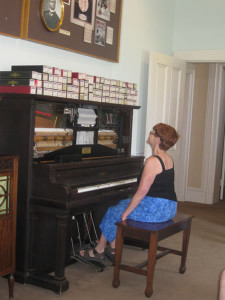 Photo by our friend Madeleine Dames:  Susana at the piano at Scott Joplin's home in St. Louis.